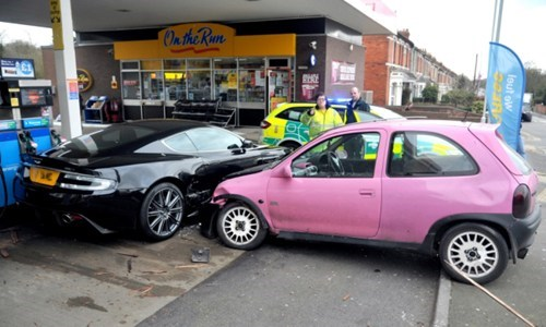This Aston Martin Got Totaled by a $200 Bubblegum Car