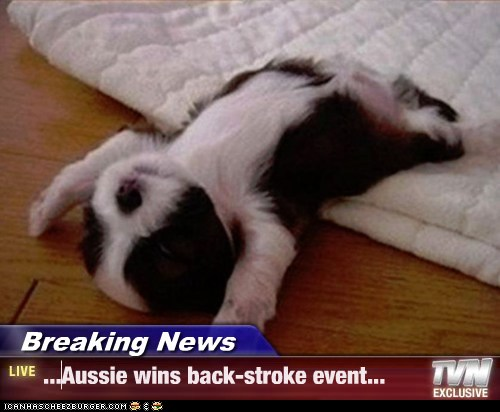 Breaking News - ...Aussie wins back-stroke event...