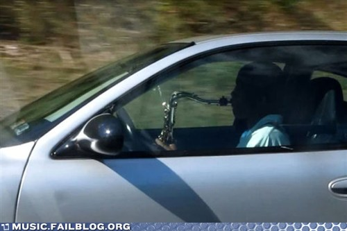 guy playing saw while driving, comedy guys defensive driving blog