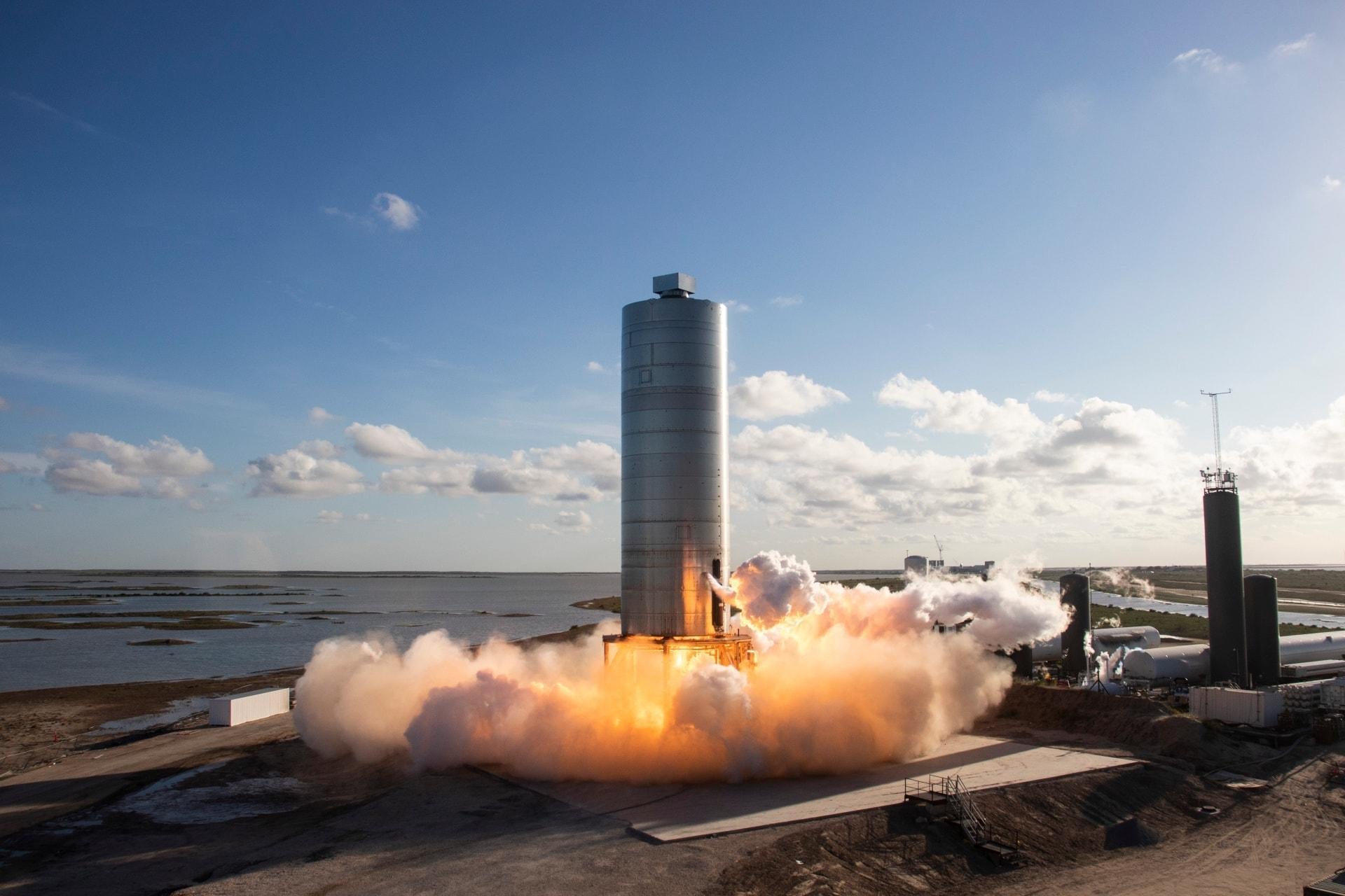 photo spacex starship sn5 launching smoke fire silver cylindrical rocket