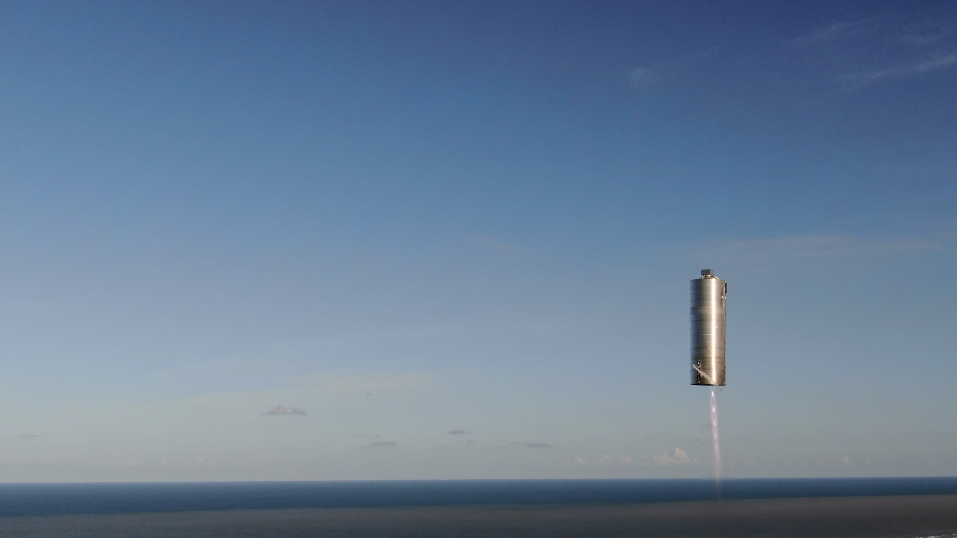photo spacex starship sn5 rocket flying against blue sky