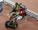 Parade Rain of the Day: Usain Bolt Gets Struck by a Segway Minutes After Winning a World Championship