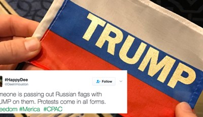 "Someone Is Handing Out Russian Flags with the Word ""Trump"" on Them at CPAC For Some Reason"