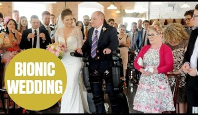 Paralyzed Dad Uses Robotic Suit to Walk His Daughter down the Aisle