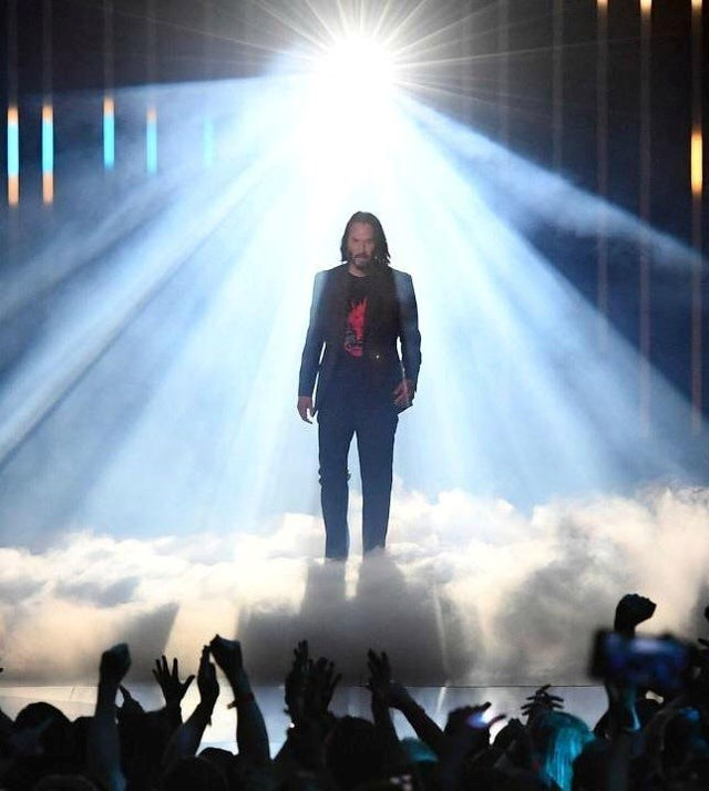 Amazing photos that could have been found as a piece of Renaissance art. The cover photo is Keanu Reeves coming on stage with bright lights illuminating him, making him look saintlike