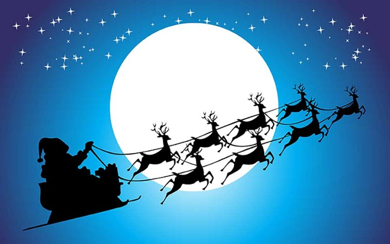 Santa reindeer are actually female | silhouette of Santa in his sled led by eight reindeer flying over the moon