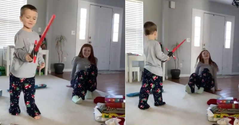 Dad's son commits to the dark side after getting a lightsaber very quickly | child holding a red lightsaber toy in his hand, in the next frame he's attacking his mother with it