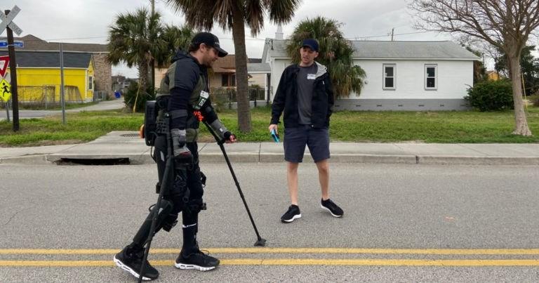 paralyzed man completes marathon wearing exoskeleton and sets new world record