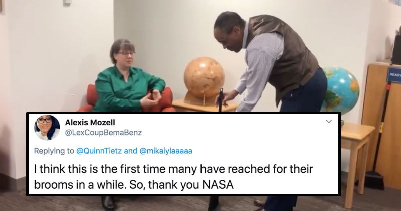 People fall for a viral video of a broom standing up by itself on Twitter | pic of a man in a vest balancing a broom while a woman in a green shirt watches tweet by Alexis Mozell @LexCoupBemaBenz Replying QuinnTietz and @mikaiylaaaaa think this is first time many have reached their brooms while. So, thank NASA