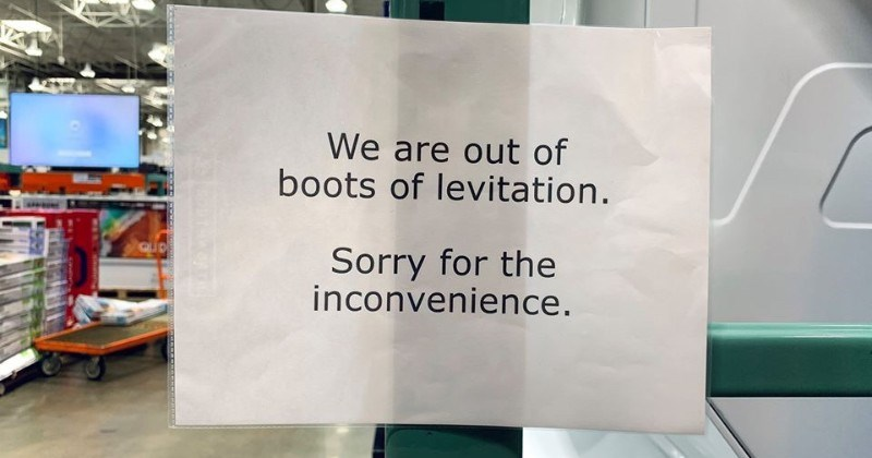 Someone replaces Costco's sold out signs with signs for magical items | are out boots levitation. Sorry inconvenience. QID sign hanging on a glass door
