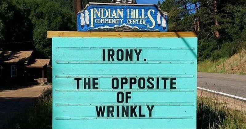 A funny sign has puns on it | INDIAN HILL COMMUNITY CENTER IRONY OPPOSITE WRINKLY