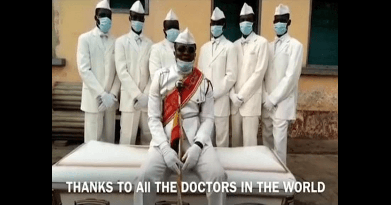 Dancing pallbearers film tribute to medical workers as they struggle with the coronavirus pandemic | Thanks to all the doctors in the world men in white suits and face masks