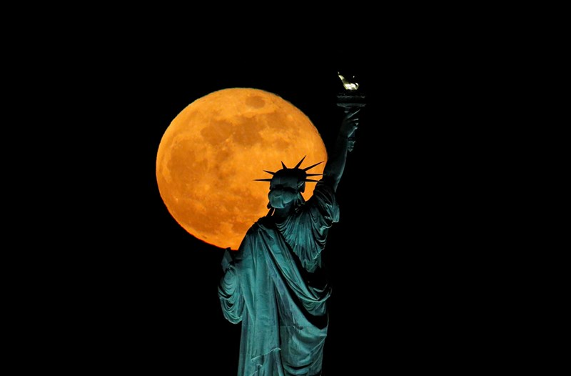 Pictures of the last Supermoon to grace the skies in 2020. The cover gif is of the Supermoon in May 2020 in the background of the Statue of Liberty in New York City