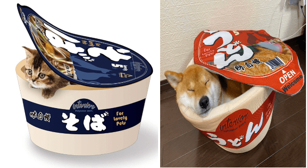 Cup Noodle Beds For Pets | pets beds shaped like instant noodle cups ramen with the lid open and a cat and shiba inu dog sleeping inside one