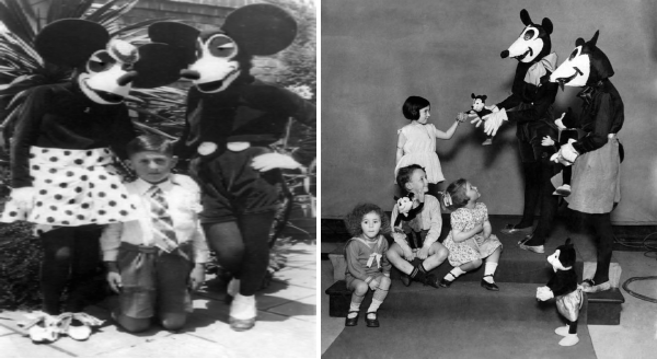 Mickey Mouse Used To Look Quite Creepy | black and white vintage photo of a boy kneeling between people dressed as mickey and minnie mouse | scary disney characters handing toys to small children