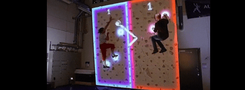 random collection of cool and interesting gifs two guys climbing adjacent climbing walls with rocks lighting up making the walls into a ping pong board