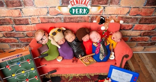 photographer newborns cast friends baby cute adorable photography pictures | six sleeping babies dressed like the friends characters sitting on a red couch under a CENTRAL PERK sign Phoebe Rachel Green Ross Geller Monica Chandler Bing Joey