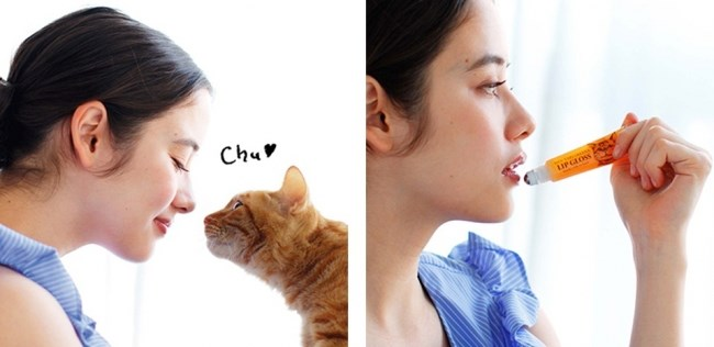 Only In Japan: a Kitten-Milk Scented Lip Gloss That Simulates Kissing a Wet Cat Nose | woman applying lip gloss from a tube and same woman about to kiss a cat's head under the word chu