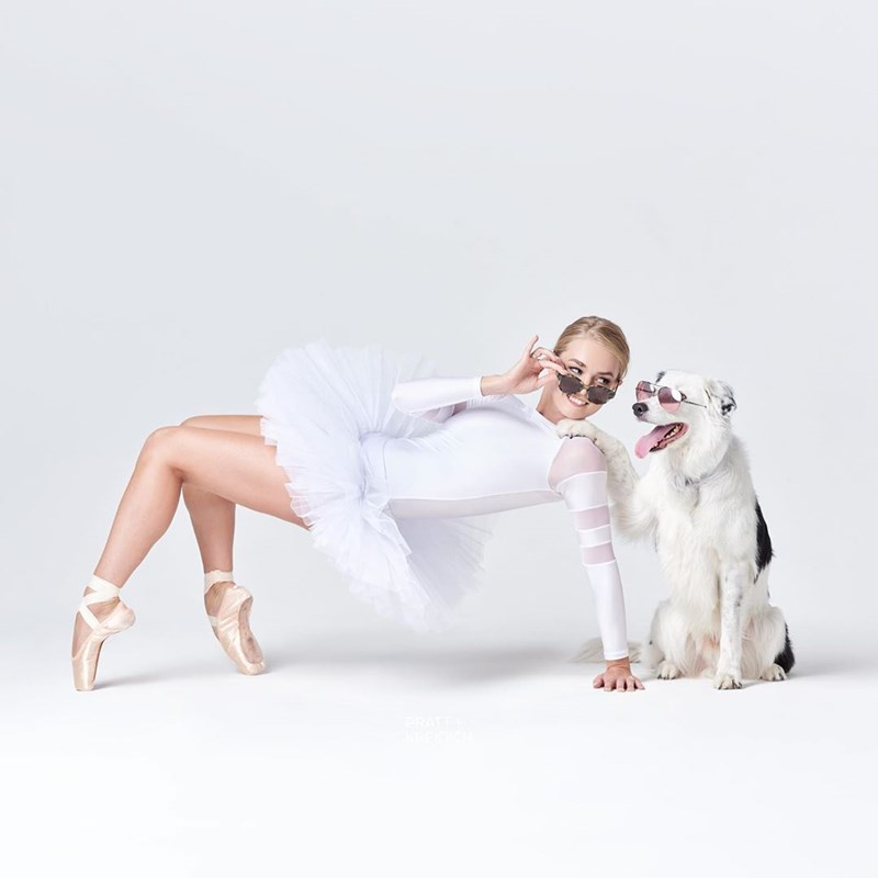 A Beautiful Photo Series Captures The Relationships Between Dancers And Their Pups | ballerina ballet dancer lowering her sunglasses next to a dog also wearing sunglasses
