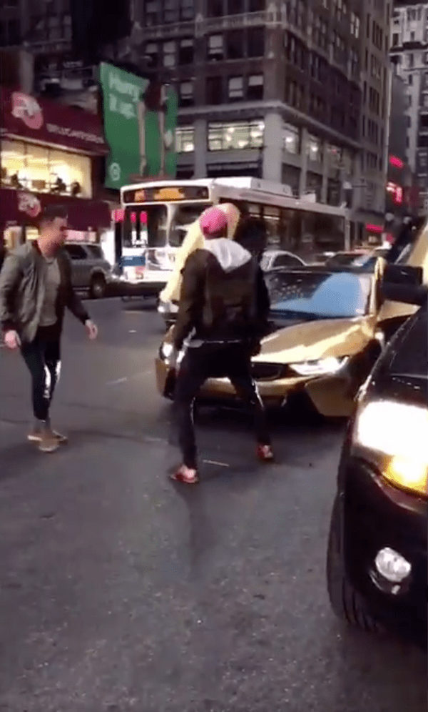 New Yorker of the Day: Man With Bat Ends Politely Asks Traffic-Blocking Photoshoot to Move