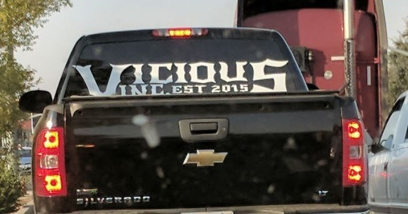 A collection of design fails that missed the mark | sticker on truck car's rear windshield that says VICIOUS INC. EST 2015 but reads vicious incest