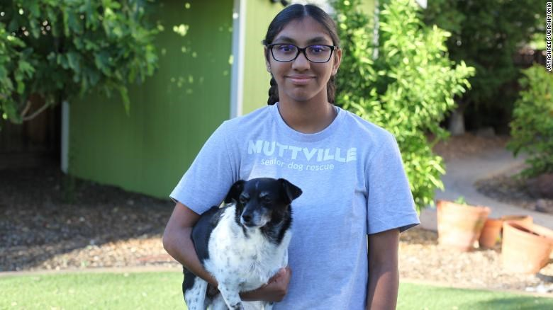 hero senior dogs adopt seniors dog rescue animals life beautiful inspiring uplifting | Meena Kumar in a Muttsville shirt holding an old dog