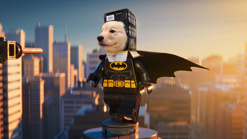 an adorable photoshopped photo of a puppy acting as the head on a batman lego for a list on a funny photoshop battle going around reddit