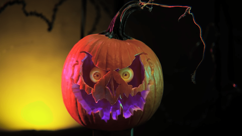 tutorial for how to carve a pumpkin with spooky eyes