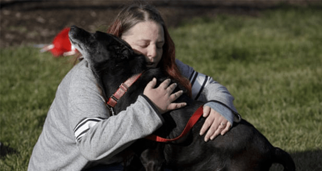 story about a dog who was reunited with her owner after three years apart thumbnail includes one picture of a girl hugging her black dog