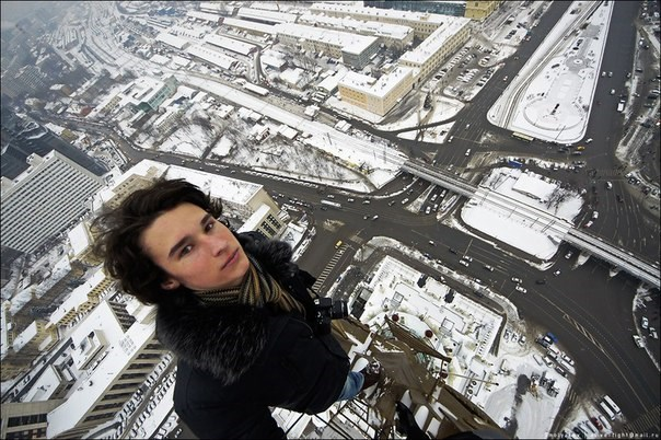 pics of guy who likes to dangle from tall buildings