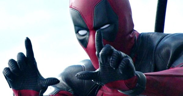 Picture of Ryan Reynolds as Deadpool with finger up as if to frame a picture or memory.
