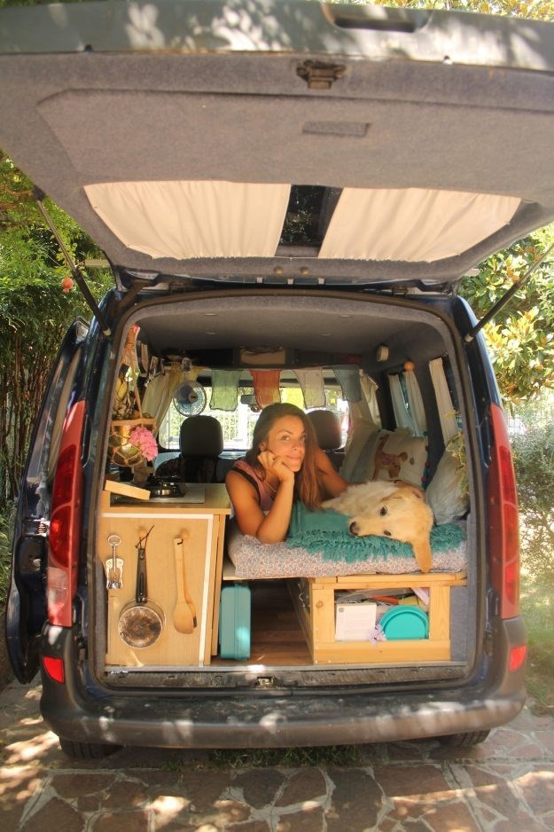 women customized an old van to travel the world with her dog