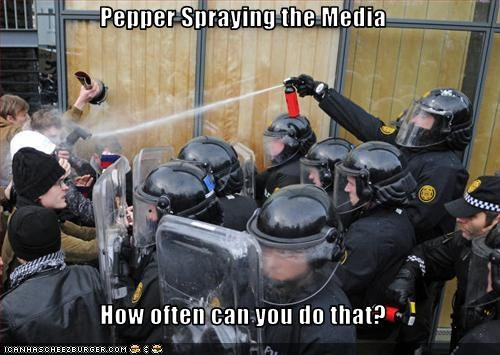 Media pepper spray police riot gear