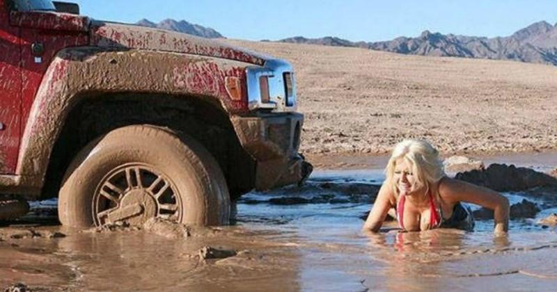 funny photo of a woman in a bikini stuck in mud