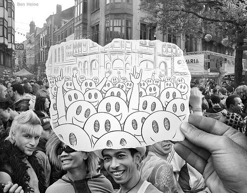 Beautiful photos combining camera with pencil by artist Ben Heine - cover image of Emoji's drawn over a crowd of people.