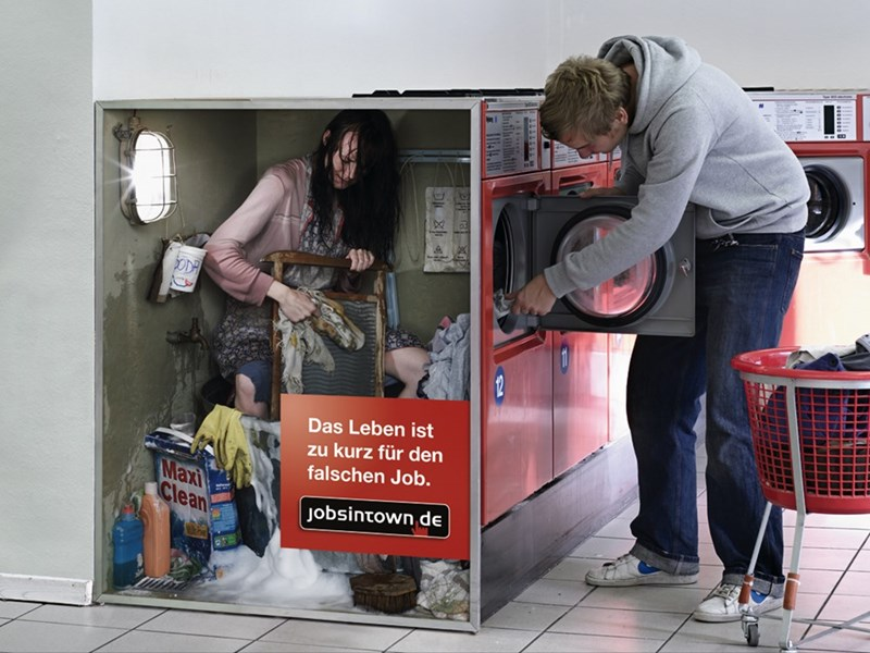 Photos of really lousy jobs - cover graphic of composite image showing a woman working inside a washing machine.
