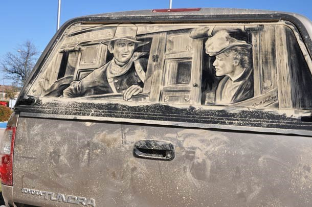 Artist Transforms Dirty Cars Into Works Of Art - Cover graphic of old western style drawing on the back of a muddy Toyota Tundra.