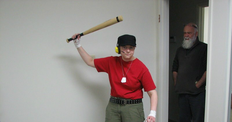 kid dressed as TF2 scout is being glared at by his disappointed father - cover image for a list of neckbeard photos