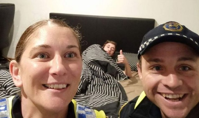 Cops take selfie with drunk guy who is passed out so he knows how he got home.