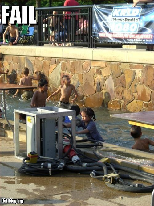 Electrical Safety Fail 4th of July Celebration - Addison, Texas 7/3/2009 Giant power cords run all along the length of a big swimming pool full of children.