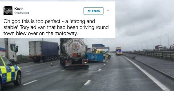 Ad van that says it's strong and stable ends up being blown over by the wind on the highway.