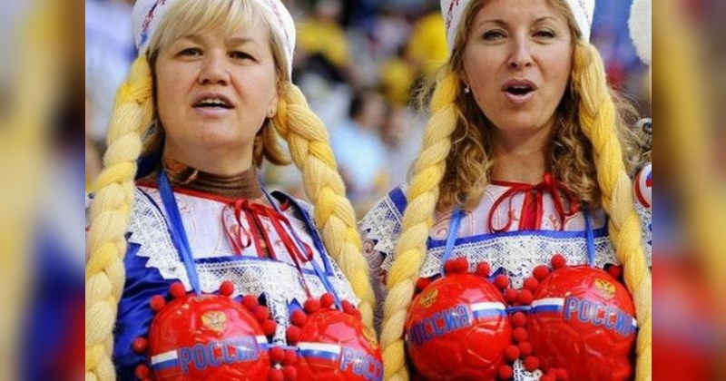 two woman standing at a soccer game wearing soccer ball bras - cover image to a list of things you'll only see in russia