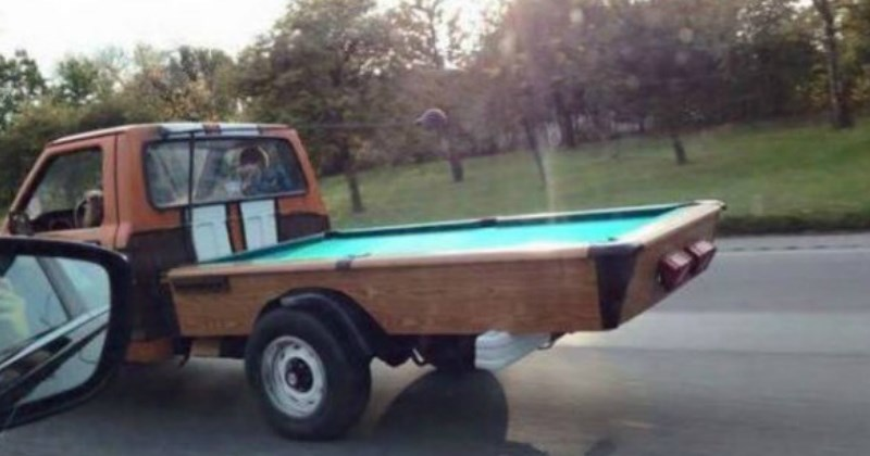 pickup truck with a pool table for a bed - cover image to a list of funny repair fails