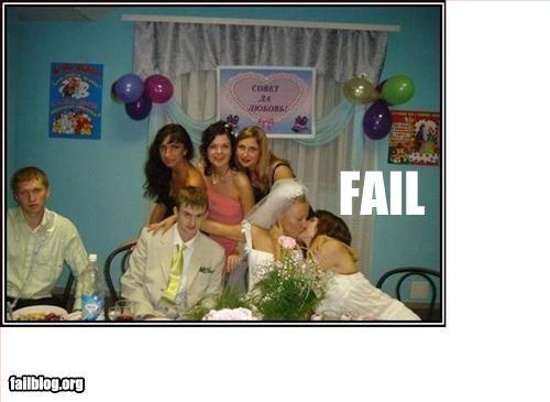 brides bridesmaid g rated kissing wedding photo