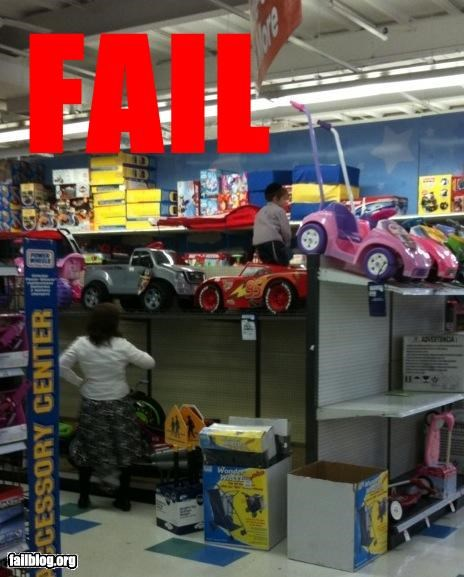 Sure kid, I don't mind if you fall to your death... At the toy store the other day I saw this mother let her son climb an unsteady shelf with giant toy cars. I was shocked, then peed my pants, then took a picture. She will not win for mother of the year.