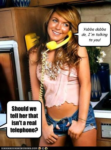 Should we tell her that isn't a real telephone? Yabba dabba do, I'm talking to you!