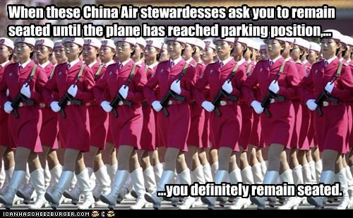When these China Air stewardesses ask you to remain seated until the plane has reached parking position,... ...you definitely remain seated.