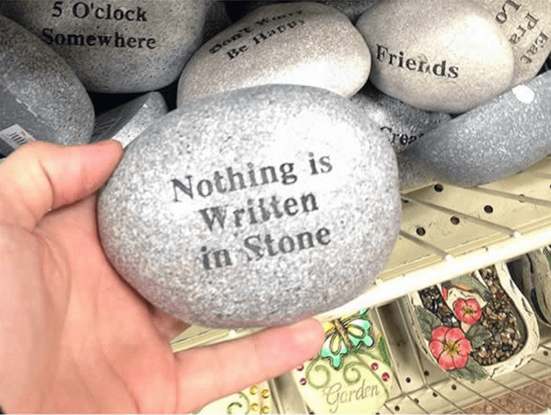 "a stone and on it ironically is written ""nothing is written on stone""- cover photo for a list of pictures that sum up what irony really is."