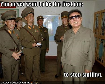 crazy dictator Kim Jong-Il laugh laughter military North Korea smile