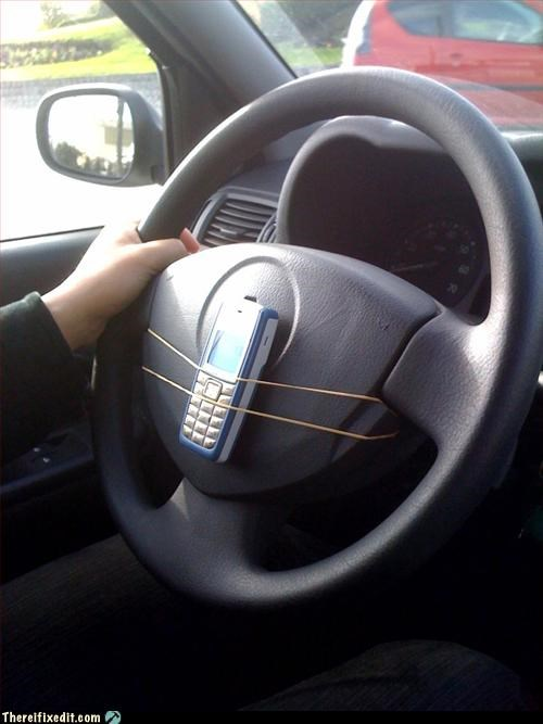 car,cell phone,Mission Improbable,rubber band,workaround